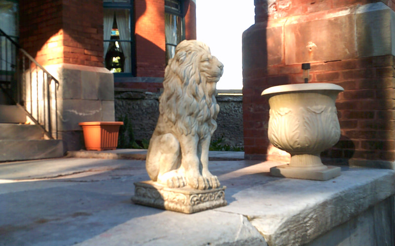 A lion statue outside of the notoriously haunted Wilson Castle in Proctor, Vermont.