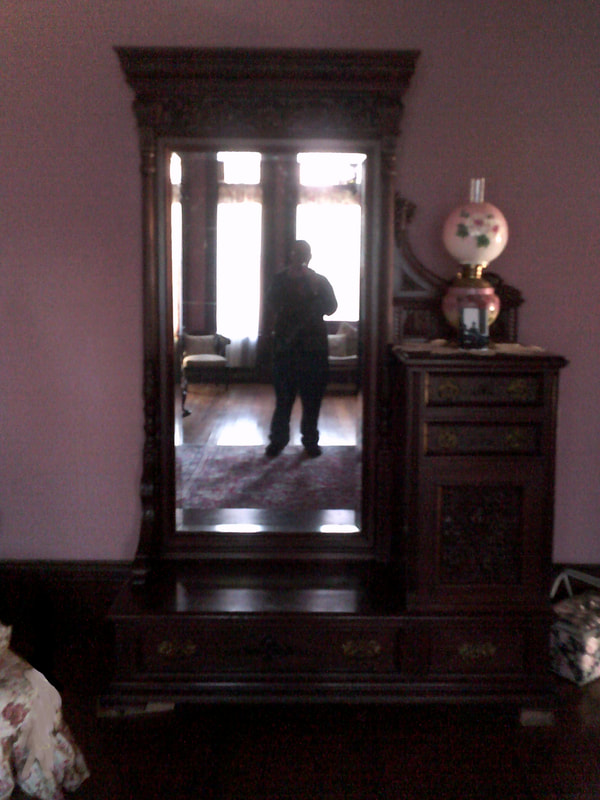 Me taking a selfie at the mirror in Sarah's Room, where ghosts are often seen in photographs at the notoriously haunted Wilson Castle in Proctor, Vermont.