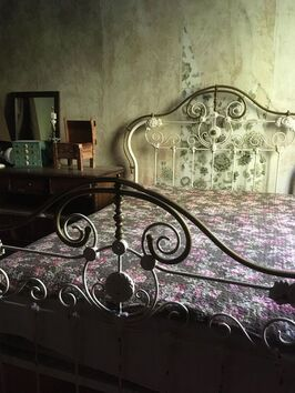 A bed in the servant's quarters of the notoriously haunted Wilson Castle in Proctor, Vermont.